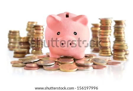 Piggybank on euro and money tower - stock photo
