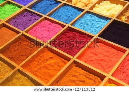 Pigment powder for sale at a market stall for artists - stock photo