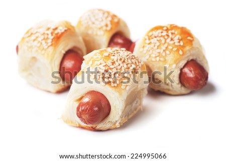 Pigs in blanket, sausage rolls with sesame covered puff pastry - stock photo