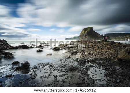 Piha Beach/ South Piha Beach with it's iconic Lion Rock is one of New Zealand's most famous surf beaches - stock photo