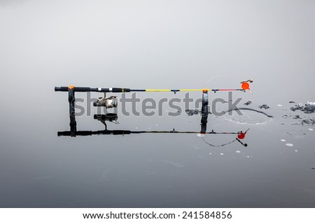 Pike ice fishing on the lake - stock photo