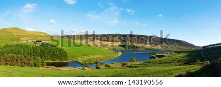Pikehead Farm, above Woodhead Reservoir with A628 Woodhead Road in distance, Peak District, UK. Panorama - stock photo