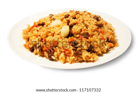 Pilaf on a white plate isolated. Eastern cuisine. A series of food in a restaurant close-up - stock photo