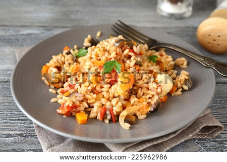 Pilaf with vegetables on a plate, tasty food - stock photo