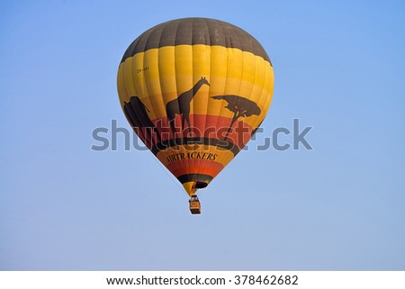 PILANESBERG NATIONAL PARK, SOUTH AFRICA - SEPTEMBER 13, 2015: Airtrackers Hot Air Balloon Safaris flies over this game rich African region. This is a very popular tourist activity.