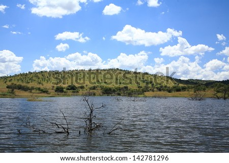 pilanesberg natural reserve park of extinct volcanoes within lunar landscape with lakes and savannah fauna clouds garden pretoria sud africa - stock photo