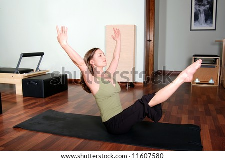Pilates Floor Pose by Professional Instructor - stock photo