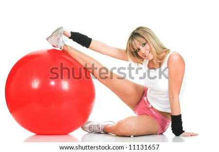 Pilates girl stretching on fit ball isolated. Pilates ball and fitness girl concept - stock photo