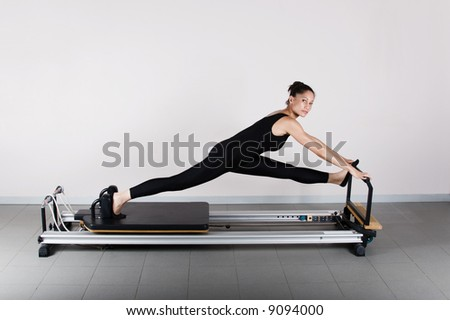 Pilates gymnastics is a Germanic evolution of yoga, used by athletes to improve flexibility and body fitness and by chiropractors for patient recovery. - stock photo