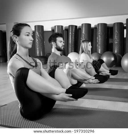 Pilates people group the seal exercise man and women at fitness gym - stock photo