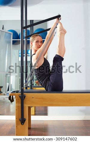 Pilates woman in reformer monki exercise at gym indoor