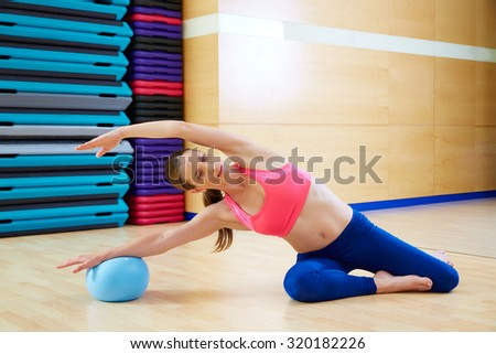 Pilates woman mermaid stability ball exercise workout at gym indoor
