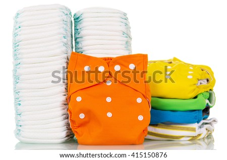 Pile cloth and disposable diapers isolated on white background. - stock photo