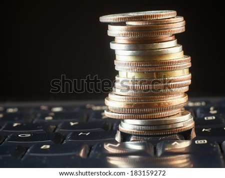 pile coins on keyboard