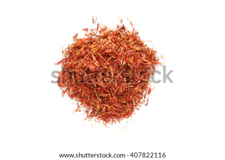 pile dried safflower on white background   - stock photo