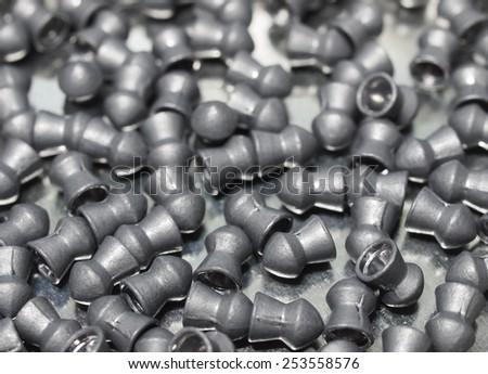 Pile lead pellets for air rifle, diabolo pellets, aluminum can of lead pellets isolated on white background - stock photo