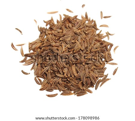Pile macro caraway isolated on white background, spice cumin in grain clipping path