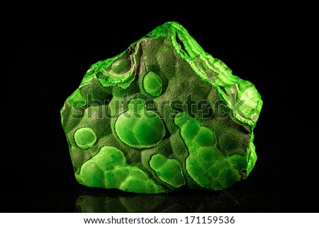 pile malachite in front of black - stock photo