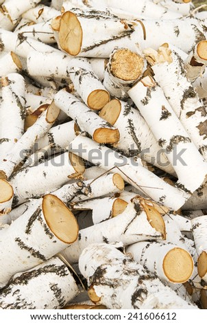 pile of a birch firewood - stock photo