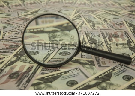 pile of american 50 dollars bills money under magnifying glass - stock photo