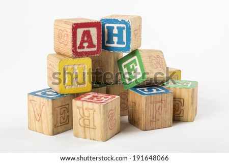 Pile of Antique Alphabet Blocks The first contact with written language a child has  - stock photo