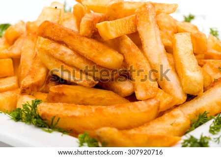 pile of appetizing french fries close up on a white background