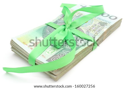 Pile of banknotes tied green ribbon for gift, isolated on white background