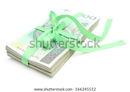 Pile of banknotes tied green ribbon for gift, isolated on white background - stock photo