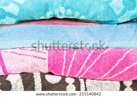 Pile of beach towels as a background image - stock photo