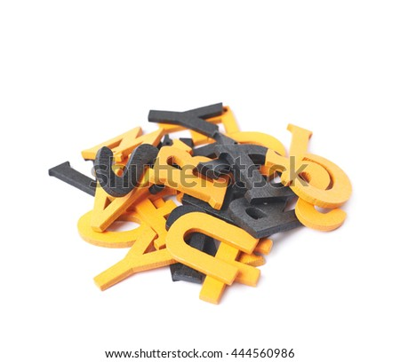 Pile of black and orange painted wooden letters isolated over the white background - stock photo