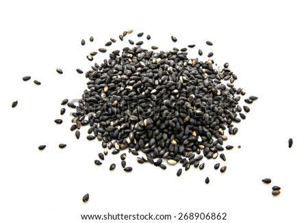 pile of black sesame isolated on white background - stock photo