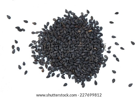 Pile of black sesame seeds isolated on white background - stock photo