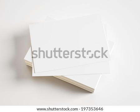 Pile of blank business cards on white background - stock photo