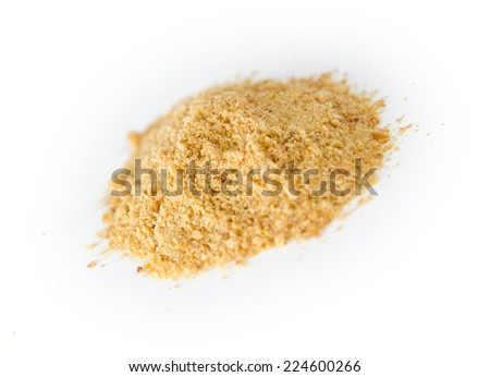 Pile of blended ground flax seeds powder - stock photo