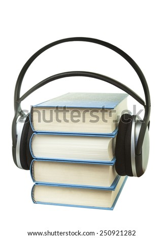 Pile of blue books with headphones.