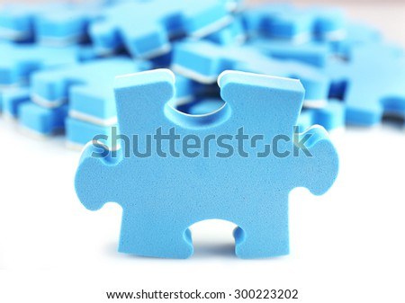 Pile of blue puzzle pieces, closeup - stock photo