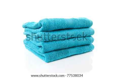 Pile of blue towels over white background