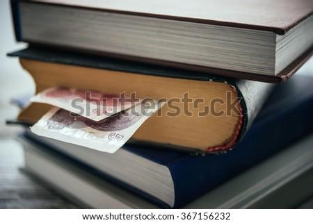 Pile of books and turkish lira bills - stock photo
