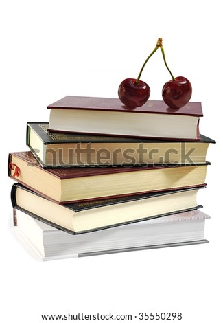 Pile of books and two sweet cherries isolated over white. - stock photo