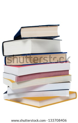 Pile of books arranged like tower over a white background. - stock photo