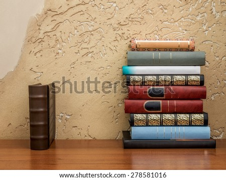 Pile of books lying on the table