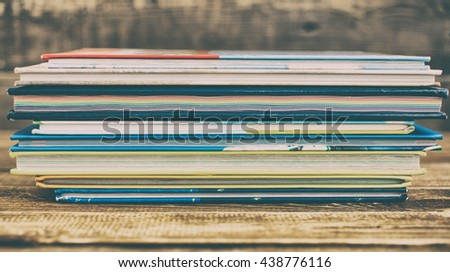 Pile of books on a wooden background. Vintage toning - stock photo
