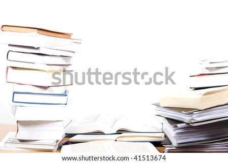 pile of books on the table