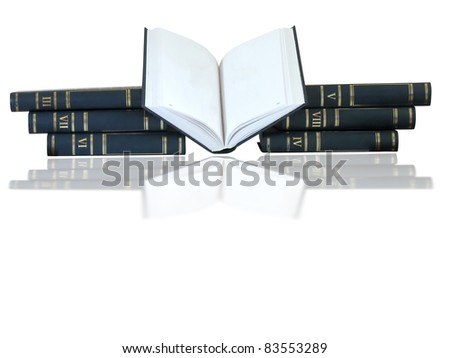 pile of books, opened one isolated on white background with reflection - stock photo