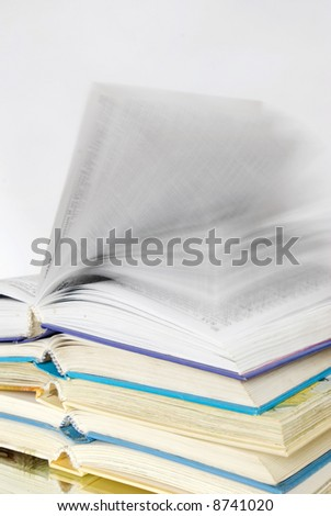 Pile of books over grey