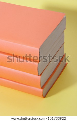 Pile of books stacked on each other - stock photo