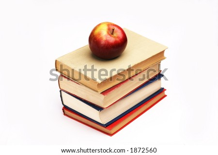 Pile of books with apple on top