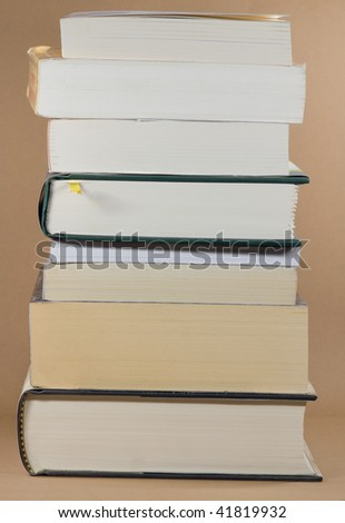 pile of books with bookmark - stock photo