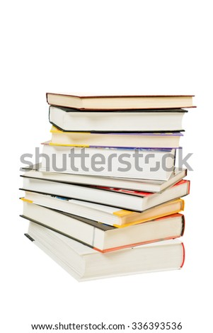 Pile of books with different colors of covers and white background