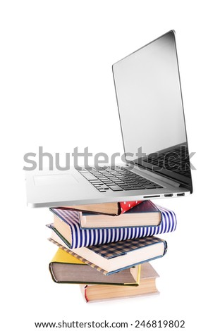 Pile of books with laptop isolated on white - stock photo